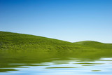 Green grass hills and blue sky poster