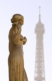 A  statue in the foreground with the Eiffel Tower in Paris poster
