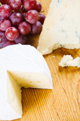 A cheese selection with grapes