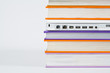 Colorful books with laptop isolated on a white background