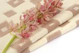 Fototapety Bath towel and cymbidium orchids