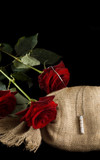 Red roses and jewellery. Isolated on Black poster