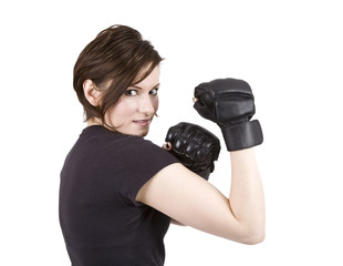 Brunette woman in boxing attire smiling at the camera.