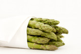 Fresh asparagus spears wrapped in a white linen cloth poster