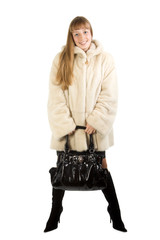Pretty young girl in fur jacket taking bag. Isolate on white.