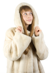 Pretty young girl in fur jacket. Isolate on white.
