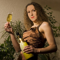 beautiful girl is drinking champagne