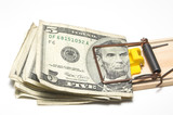Money caught in a mousetrap. Financial concept. poster