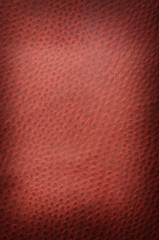 Red spotted leather background close up