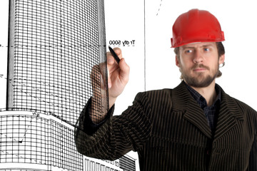An image of constructor in a rad helmet drawing with a pen