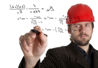 An image of constructor in a rad helmet writing with a pen