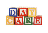 Abc blocks lined up to spell the word daycare - isolated poster