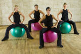 Fototapety A group of women making exercise sitting on big balls.