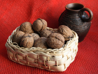 Basket with nuts and a jug.