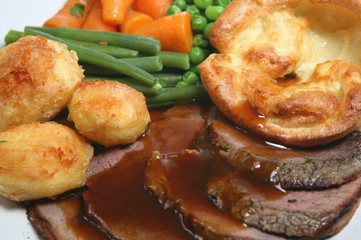 Roast beef dinner with yorkshire pudding and vegetables