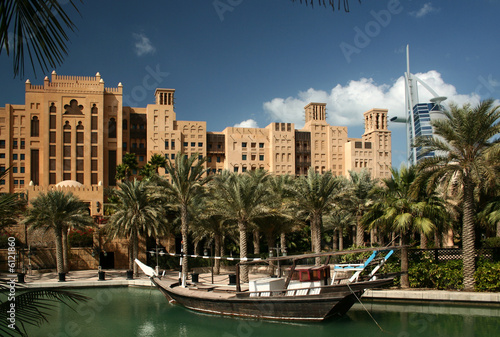 Dubai, Madinat Jumeirah park with the lake and the boat