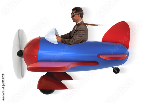 adult man in toy airplane on white background
