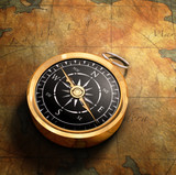 An old fashoned brass compass on a Treasure map background poster