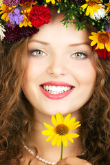 Beautiful young woman wearing a flower  diadem..