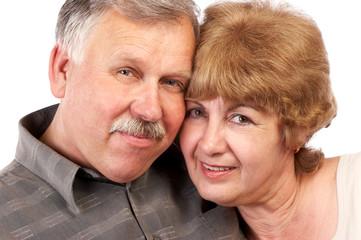 happy elderly couple in love. over white background.