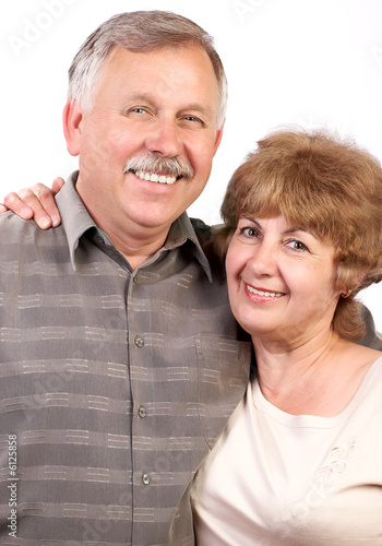 happy elderly couple in love. over white background.
