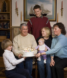 Grandfather receiving birthday cake poster