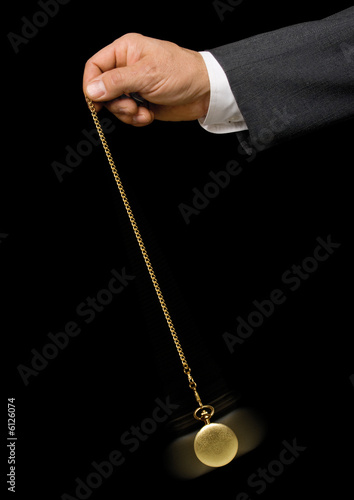 Man's hand holding a pocket watch
