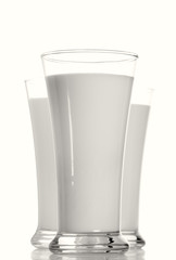 three milk glasses in row, focus on the first one