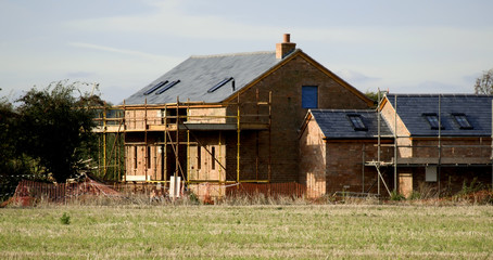 A house undergoing building work.
