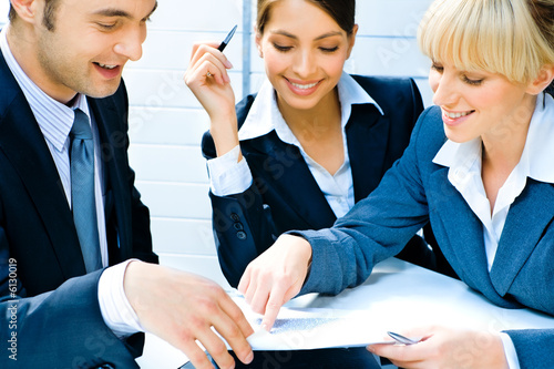 Business woman demonstrating her plan to co-workers
