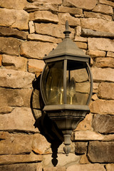Old Lamp on Stone Wall