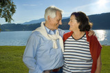 Fototapety attractive married mature couple enjoying the sunset.