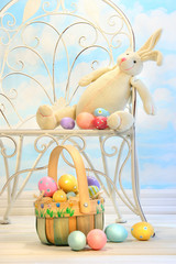 Easter bunny with eggs on garden chair
