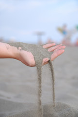 fine sand leaking through hands