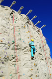 Woman climing a rock wall