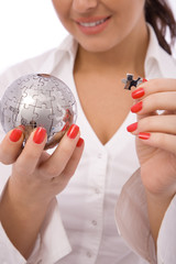 business concept with a globe puzzle and businesswoman