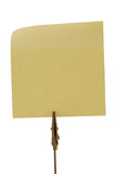 Clamp holding one yellow post-it, isolated on white. poster
