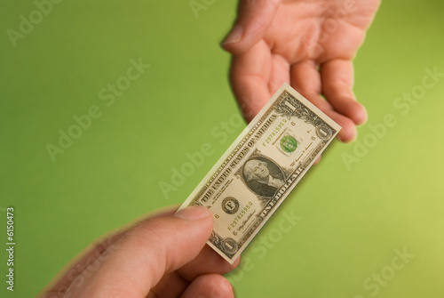 a transaction with a miniature dollar bill