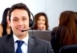 customer service representative man - smiling in his office