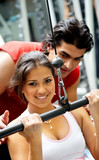 gym woman and her trainer doing weights exercises poster