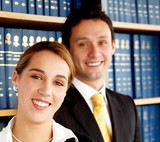 business woman with her partner in an office smiling poster