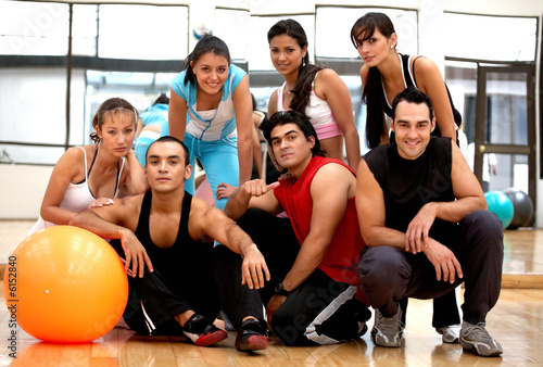 group of people at the gym smiling