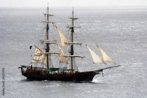 Pirate ship that is out to sea and sailing away
