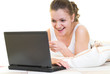 Surprised girl with laptop in her bed. Isolated.