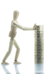 Manikin pushing coins pile with both hands