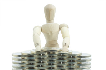 Manikin standing behind and building financial wall