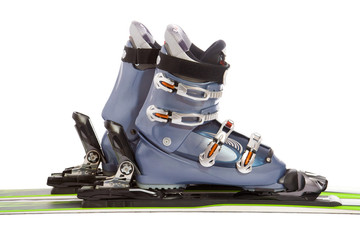Modern ski and boot isolated on white background