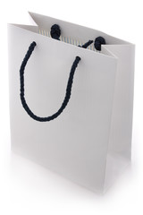Isolated white shopping bag with blue handles