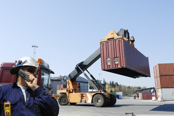 engineer and forklifts in container port