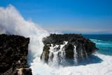 Ocean waves crushing against cliff poster
